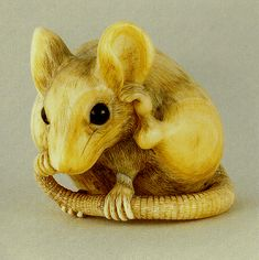 An Ivory Netsuke Rat ~ Netsuke are miniature carvings, usually of ivory, used as toggles or fasteners in traditional Japanese dress. Description from pinterest.com. I searched for this on bing.com/images