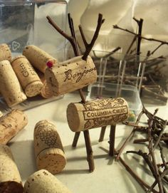 how to make cork angel ornaments, with picture | Here he is surrounded by the supplies for his creation. Wine corks ...