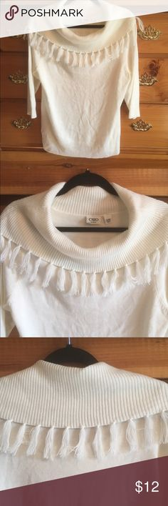 Cute sweater 14/16 white 🌺🌺🌺 This is a really pretty sweater from Cato it is a size 1416 it is white it has an off the shoulder type cow neck collar with fringe. Really pretty nice addition to your closet Cato Sweaters Crew & Scoop Necks