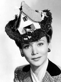 Actress Carol Landis. No, this is not photoshop, this is a real chapeau that is sitting on her head!