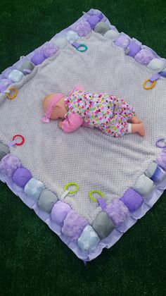 Activity play mat with loops to interchange toys and make tummy time fun!  Indoor/outdoor, travel padded floor mat