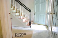 Finishing the Foyer with Painted wood floors, Painted exterior doors, Painted Banister and a primitive oak dresser