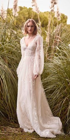 Romantic Flowing Wedding Dress with Balloon Sleeves