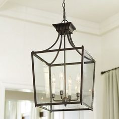 Our Sheffield Chandelier features four candle arms within the classic lantern silhouette. The scale of the glass-paneled, metal frame is designed so that you … chandelier Sheffield Chandelier Entryway Chandelier, Lantern Chandelier, Chandelier Shades, Chandelier Lighting, Lantern Light Fixture, Iron Chandeliers, Room Lights, Ceiling Lights, Gas Lights