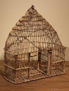 60 - 80 year old bird cage from India - Wire frame with distressed off white paint - Inside features a swing, food tray, water tray Dimensions: 15 x 11 x 18