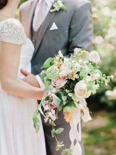 Sweet overflowing Spring bouquet: http://www.stylemepretty.com/2016/02/11/classic-springtime-dunaway-gardens-wedding/ | Photography: Amy Arrington - http://www.amyarrington.com/