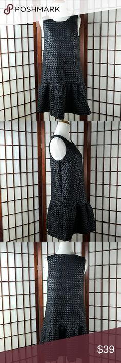 """ELLE COLLECTION Textured Beauty Black Dress Pre-owned excellent condition no issues  ELLE COLLECTION SIZE SMALL  Textured (geometric) dress style Sleeveless  Black color  Lined  Made of polyester and spandex  See photos for more details   Measurements Approximate  Pit to pit 17"""" Shoulder to hem 33"""" Waist 38"""" Elle Dresses"""