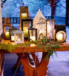 Christmas Entry Table-really like this eclectic mix of lanterns with greenery, could also be autumnal with gourds