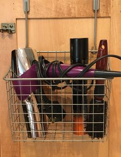 Cabinet shelf basket for hair supplies.