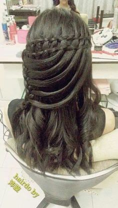 double twist waterfall, looped into side lace braid, very nice..........