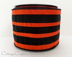 """Shiny orange and orange knit stripes are interfaced and bonded to a black solid fabric, 4"""" wide with a sturdy wired edge covered in lack thread. Premium decor ribbon by RAZ Imports, the layered fabrics provide significant body to the ribbon."""
