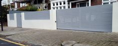 front boundary wall screen automated electronic gate installation grey wooden fence bike store modern garden design balham clapham london (16)