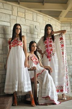 This is almost the look I want for the wedding party. Coordinated but not the same silhouette for each lady.