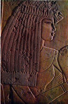 Lady in Waiting: detail of a limestone relief representing a festive gathering, in the tomb of the vizier Ramose at Thebes, New Kingdom, XVIIIth Dynasty, approx. 1400-1362B.C.