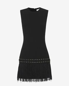 Elizabeth and James Eron Fringe Dress: Black: This sleeveless mini dress shape has flirty fringe swinging at the bottom portion. Grommet detailing. Back zip closure. Lined. In black.  Fabric: 54% polyester/38% viscose/8% elastane Lining: 100% polyester Made in China.   Model Measurements: Height ...