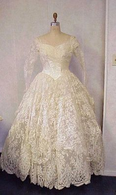 I think this is what's been circling in my head...  Vintage 1950s wedding dress  lace satin antebellum style