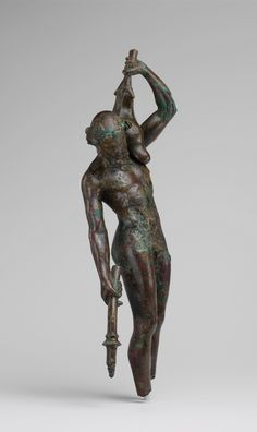 Bronze statuette of a satyr with a torch and wineskin Period: Hellenistic Date: 3rd–2nd century B.C. Culture: Greek Medium: Bronze. | The Metropolitan Museum of Art