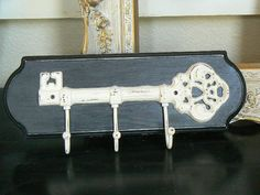 Upscaled  Iron Key Hook Plaque Paris Apartment  in Black and Ivory. $22.50, via Etsy.