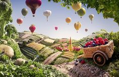 The scenes are photographed in layers from foreground to background, as the process is very time-consuming and the food quickly wilts under the lights. Here, hot air balloons made of a variety of fruit and veg soar over fields of asparagus, courgettes, beans and corn