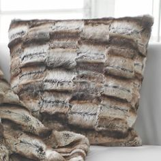 Add a touch of texture to your sofa or settee with this lovely pillow, showcasing a faux fur design for eye-catching appeal.   Prod...