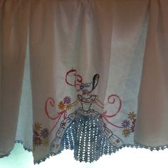 Vintage pillow case section as center of curtain valance.