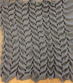 Smocking sample - hand-smocked structural fabric manipulation with a repeating leaf like pattern - texture with fabric; creative sewing; textiles design // Ashley Gallerani