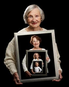Woman aging holding self portraits. So cool.