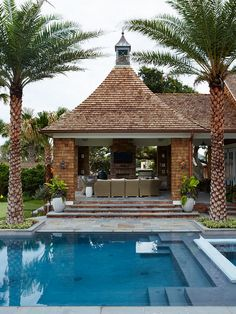 Pool Pavilion. Pool Pavilion Ideas. Shingle Cedar Shake Pool Pavilion. Pool Pavilion with barbecue - covered patio, outdoor fireplace, shingle, wicker furniture. The overall pavilion is approximately 20'x20' exterior.