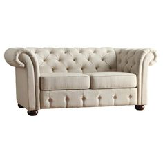 Showcasing tufted linen upholstery and rolled arms, this stately wood-framed loveseat brings polished elegance to your living room seating group or den decor...