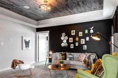 The textured ceiling adds a nice contrast to the accent wall.