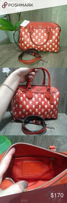 Floral print Coach handbag Coach Bennett in floral print orange. Handbag is a satchel crossbody with single zipper. On slip pocket and one zipper. Flowers are cream in color and hardware is in silver. NWT never used. Coach Bags Crossbody Bags