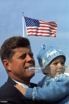 News Photo : Presidential candidate John F. Kennedy holding...