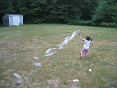 Samantha, age 5, making bubbles in the backyard. Submitted by Donna C. -- Choose your favorite photo and submit your vote by August 6, 2012 for a chance to win a gift card for children's books!