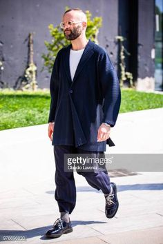Angelo Flaccavento wearing blue jacket is seen in the streets of Milan after the Neil Barrett show during Milan Men's Fashion Week Spring/Summer 2019...