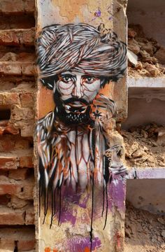 Street Art By C215 - New Delhi (India) ... pretty sure this is based on a McCurry photograph!