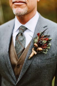 Winter boutonniere for your groom and groomsmen