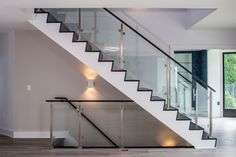 Pikesville, MD: Contemporary glass stair railing.  www.jpaulbuilders.com/?utm_content=buffer0f76b&utm_medium=social&utm_source=pinterest.com&utm_campaign=buffer | #JPaulOldCourt