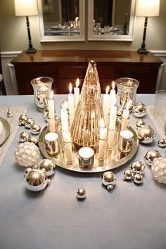 Christmas tablescape.  Love the mini spice jars as candlestick holders.