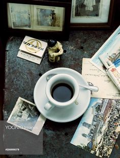 Yooniq images - A Travelers Espresso Setting With Pictures And Postcards.