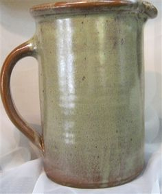 """Large water pitcher. Great for ice tea, water, lemonade, and other liquids. Handmade by Traditions Pottery . About 10"""" tall. Holds about 1.5 quart"""