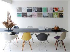 very long Alinea table Eames fiberglas chairs