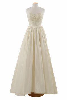 Brides.com: Style Inspiration: Interior Design. White satin appliqués create tone-on-tone dimension on this taffeta gown's bodice  Constance gown, $3,275 Vineyard