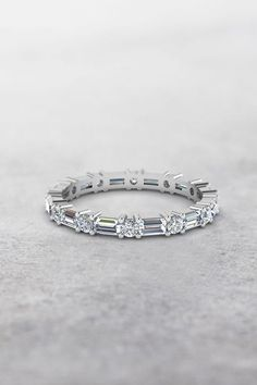 Baguette And Round Eternity Bands with Diamonds in 14K White Gold exclusively styled by Fascinating Diamonds
