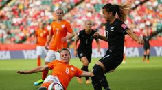 EDMONTON, AB - JUNE 06: Sherida Spitse #8 of Netherlands slides to save the ball from going out of bounds with pressure from Ali Riley #7 of New Zealand during the FIFA Women's World Cup Canada 2015 Group A match between New Zealand and Netherlands at Commonwealth Stadium on June 6, 2015 in Edmonton, Alberta, Canada (Photo by Maddie Meyer - FIFA/FIFA via Getty Images)