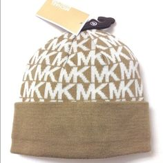 Michael Kors beanie Tan and cream colored. New, never worn Michael Kors Accessories Hats