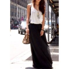 """♦️LAST ITEM♦️ ✨SOFT BLACK  FLOWY MAXI SKIRT - MED✨ Beautiful soft flowy maxi skirt in Black is so soft, and flows beautifully. An instant classic in anyone's wardrobe. Amazing quality. Fabric is non-sheer. This will be your go-to skirt year round. Runs true to size. Length is 39""""; 96% Rayon; 4% Spandex. MADE IN tHE USA  🇺🇸. THIS LISTING IS FOR A MEDIUM, AND AVAILABLE  TO PURCHASE. Boutique Skirts Maxi"""