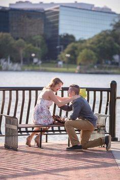 Surprise Orlando proposal photography at Lake Eola in downtown captured by top Orlando wedding photographer followed by engagement photos.