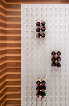 You could make a wine rack to fit any space like this
