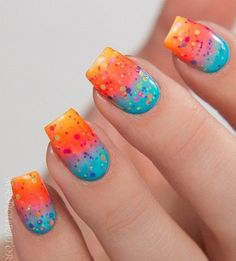 The Multi Dotted Nails. This one is all about colors. The nail art has lot going on. With the gradient base and multi-colored dots above, this nail art design has got my mind.