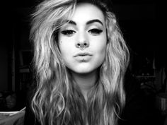 Septum and labret.  Also, she is so pretty and I love her hair and makeup.